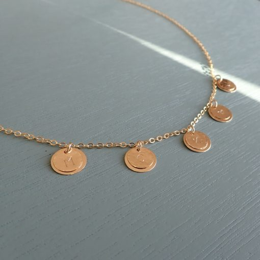 Gold five layered disc necklace